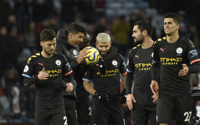Manchester City's Sergio Aguero, center, with teammates leave the field after the English Premier League soccer match between Aston Villa and Manchester City at Villa Park in Birmingham, England, Sunday, Jan. 12, 2020. Manchester City won the game 1-6. (AP Photo/Rui Vieira)