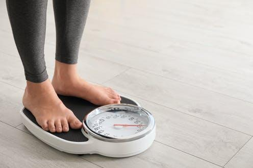 """<span class=""""caption"""">People who lost weight had higher levels of certain beneficial bacteria in their gut.</span> <span class=""""attribution""""><a class=""""link rapid-noclick-resp"""" href=""""https://www.shutterstock.com/image-photo/woman-standing-on-scales-indoors-space-1466472452"""" rel=""""nofollow noopener"""" target=""""_blank"""" data-ylk=""""slk:New Africa/ Shutterstock"""">New Africa/ Shutterstock</a></span>"""