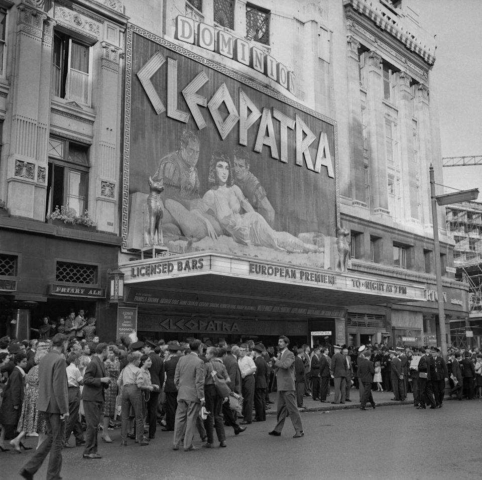 <p>Crowds gather at the entrance of the Dominion Cinema for the London premiere of <em>Cleopatra</em> on August 19, 1963. Star Elizabeth Taylor was the first actor to get paid $1 million for a movie role. Today, her groundbreaking <em>Cleopatra</em> paycheck would equate to approximately $8.4 million.<br></p>