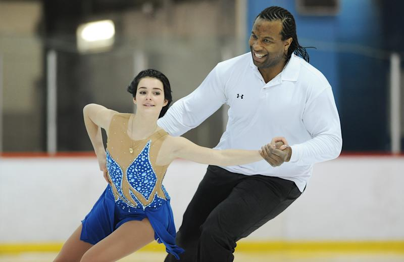 Former NHL tough guy Georges Laraque skates with Jade-Savannah Godin in Ste-Julie, Quebec.,  Wednesday, April 6, 2011. (AP Photo/The Canadian Press, Graham Hughes)