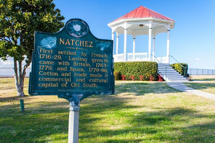 """<p><strong>Established in:</strong> 1716</p><p><a href=""""https://www.britannica.com/place/Natchez-Mississippi"""" rel=""""nofollow noopener"""" target=""""_blank"""" data-ylk=""""slk:Jean-Baptiste Le Moyne de Bienville"""" class=""""link rapid-noclick-resp"""">Jean-Baptiste Le Moyne de Bienville</a> established Natchez in 1716 as Fort Rosalie. It was later named for the Natchez Native Americans and was passed from France to England. It is now known as being the most active slave trading city in the state. <br></p>"""