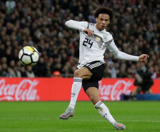 FILE - In this Friday, Nov. 10, 2017 filer, Germany's Leroy Sane fires a shot during the international friendly soccer match between England and Germany at Wembley stadium in London. At the World Cup four years ago, Colombia forward James Rodriguez became one of the stars of the tournament and shot to international fame with his trickery on the ball and eye for a spectacular goal. Here's a look at young players hoping to make a similar impact at this year's World Cup in Russia. Among them is France left back Benjamin Mendy, Spain midfielder Marco Asensio, Belgium winger Leroy Sane, and Brazil striker Gabriel Jesus. (AP Photo/Matt Dunham, File)