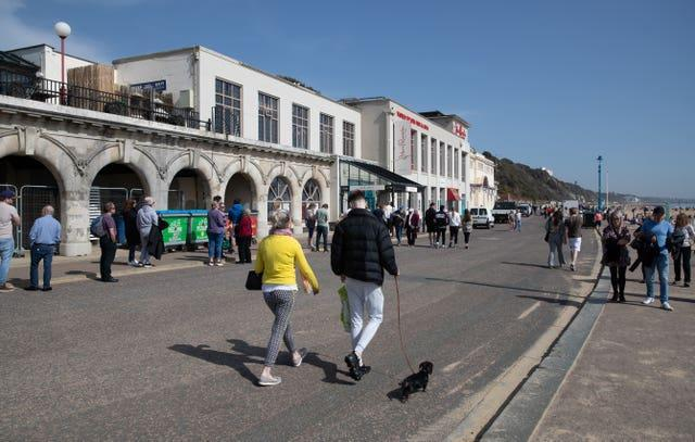 People walk along the sea front in Bournemouth