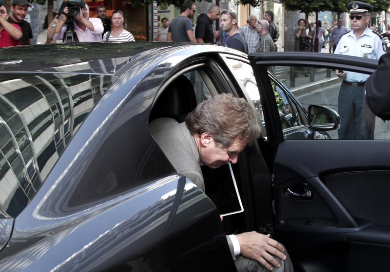International Monetary Fund (IMF) mission chief Poul Thomsen exits his car as he arrives for a meeting between Greece's finance minister Yannis Stournaras and the debt inspectors from the European Central Bank, European Commission and International Monetary Fund, known as the troika, at Greece's Finance ministry in Athens, on Friday, Sept. 21, 2012. Debt-strapped Greece is negotiating a major new austerity package worth more than euro 11.5 billion ($15.1 billion) with its rescue lenders. (AP Photo/Dimitri Messinis)