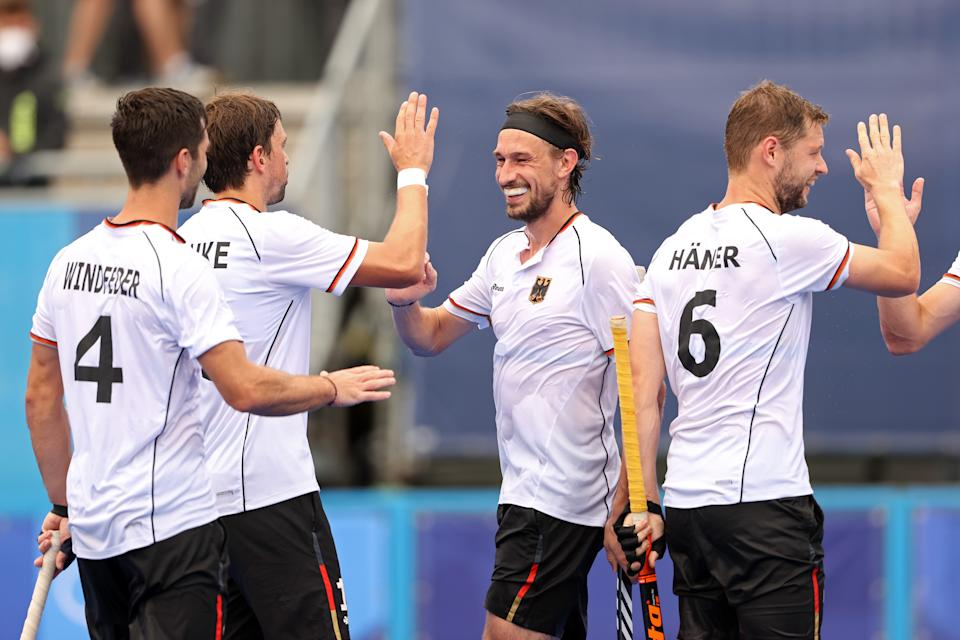 TOKYO, JAPAN - JULY 27: Florian Fuchs of Team Germany scores the fifth goal and celebrates with teammates during the Men's Preliminary Pool B match between Great Britain and Germany on day four of the Tokyo 2020 Olympic Games at Oi Hockey Stadium on July 27, 2021 in Tokyo, Japan. (Photo by Alexander Hassenstein/Getty Images)