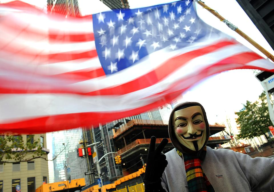 Occupy Wall Street protester Guy Fawkes with American flag at Zuccotti Park, (Photo By: Robert Sabo/NY Daily News via Getty Images)