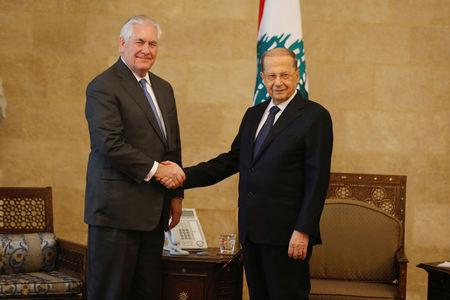 Lebanon's President Michel Aoun shakes hands with U.S. Secretary of State Rex Tillerson at the presidential palace in Baabda, Lebanon February 15, 2018. REUTERS/Mohamed Azakir