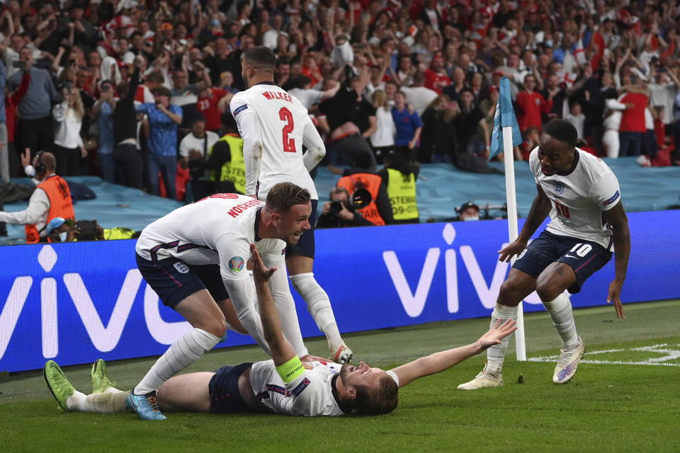 England's Harry Kane, bottom, celebrates scoring his side's second goal during the Euro 2020 soccer semifinal match between England and Denmark at Wembley stadium in London, Wednesday, July 7, 2021. (Laurence Griffiths/Pool Photo via AP)