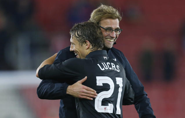 """Football Soccer - Southampton v Liverpool - Capital One Cup Quarter Final - St Mary's Stadium - 2/12/15 Liverpool manager Juergen Klopp and Lucas Leiva celebrate at the end of the match Reuters / Eddie Keogh Livepic EDITORIAL USE ONLY. No use with unauthorized audio, video, data, fixture lists, club/league logos or """"live"""" services. Online in-match use limited to 45 images, no video emulation. No use in betting, games or single club/league/player publications. Please contact your account representative for further details."""
