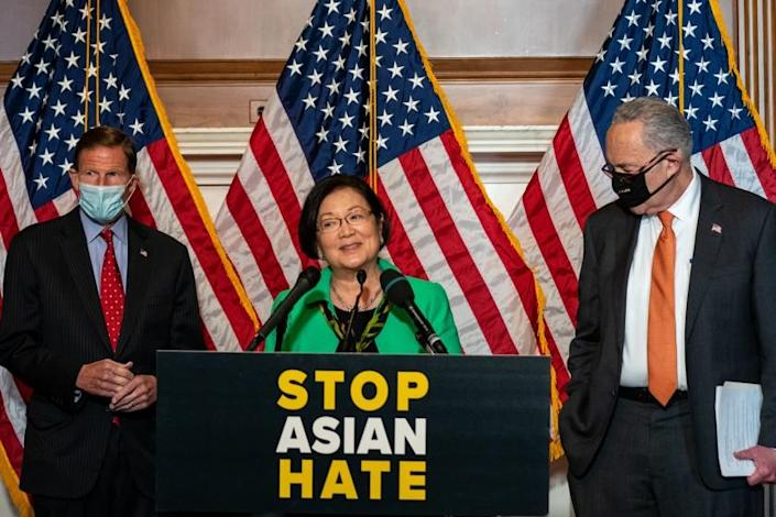 WASHINGTON, DC - APRIL 22: Sen. Mazie Hirono (D-HI), center, flanked by Sen. Richard Blumenthal, (D-CT), left, and Senate Majority Leader Chuck Schumer (D-NY), right, speaks during a news conference about the passage of S. 937, Covid-19 Hate Crimes Act on Capitol Hill on Thursday, April 22, 2021 in Washington, DC. The Bill passed, amended by a vote of 94-1, with Sen. Josh Hawley was the lone vote against. (Kent Nishimura / Los Angeles Times)