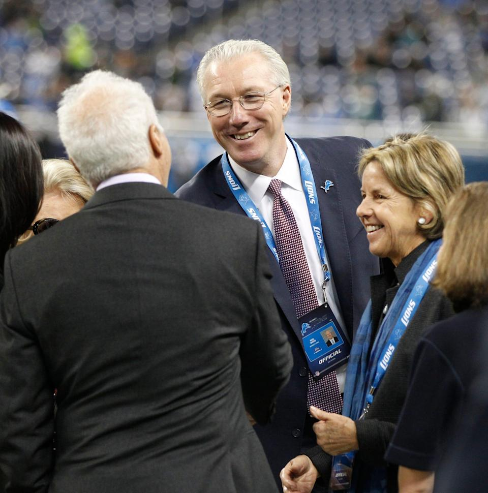 Detroit Lions Team President Rod Wood, center, next to Lions Vice Chair Sheila Ford Hamp shakes hands with Philadelphia Eagles owner Jeffrey Lurie, left back to the camera, on the sidelines before the Lions' football game against the Philadelphia Eagles on November 26, 2015, in Detroit.