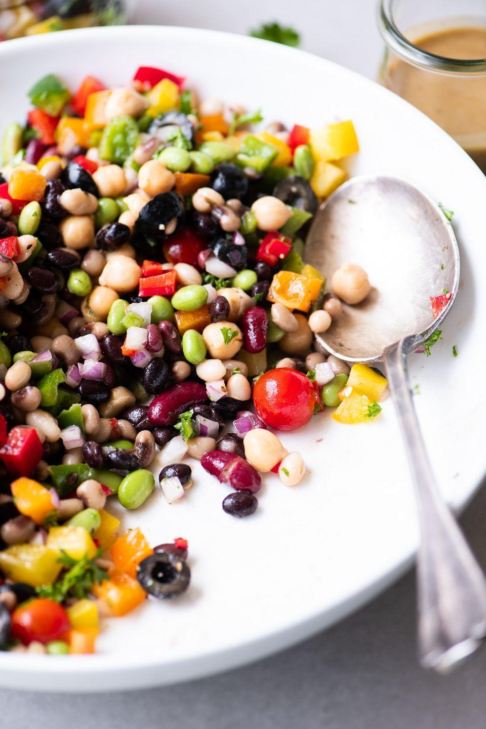 """<p>Get the <a href=""""https://theviewfromgreatisland.com/rainbow-bean-salad-with-sweet-and-sour-dressing-recipe/"""" rel=""""nofollow noopener"""" target=""""_blank"""" data-ylk=""""slk:Rainbow Bean Salad"""" class=""""link rapid-noclick-resp"""">Rainbow Bean Salad</a> recipe. </p><p>Recipe from <a href=""""https://theviewfromgreatisland.com/"""" rel=""""nofollow noopener"""" target=""""_blank"""" data-ylk=""""slk:A View From Great Island"""" class=""""link rapid-noclick-resp"""">A View From Great Island</a>.</p>"""