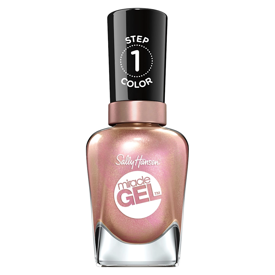 """While super sparkly in the bottle, this iridescent rose-gold glitter actually goes on quite sheer—even after three coats. It's the perfect shade if you're going for natural nails but slightly sparklier. What's better: Sally Hansen upgraded its <a href=""""https://shop-links.co/1712638856305359318"""" rel=""""nofollow noopener"""" target=""""_blank"""" data-ylk=""""slk:Miracle Gel Top Coat"""" class=""""link rapid-noclick-resp"""">Miracle Gel Top Coat</a> formula this summer, so the finish is shinier and lasts even longer. Who doesn't love that? <em>—Macaela Mackenzie, senior health editor</em> $10, Sally Hansen. <a href=""""https://shop-links.co/1712534514448184861"""" rel=""""nofollow noopener"""" target=""""_blank"""" data-ylk=""""slk:Get it now!"""" class=""""link rapid-noclick-resp"""">Get it now!</a>"""
