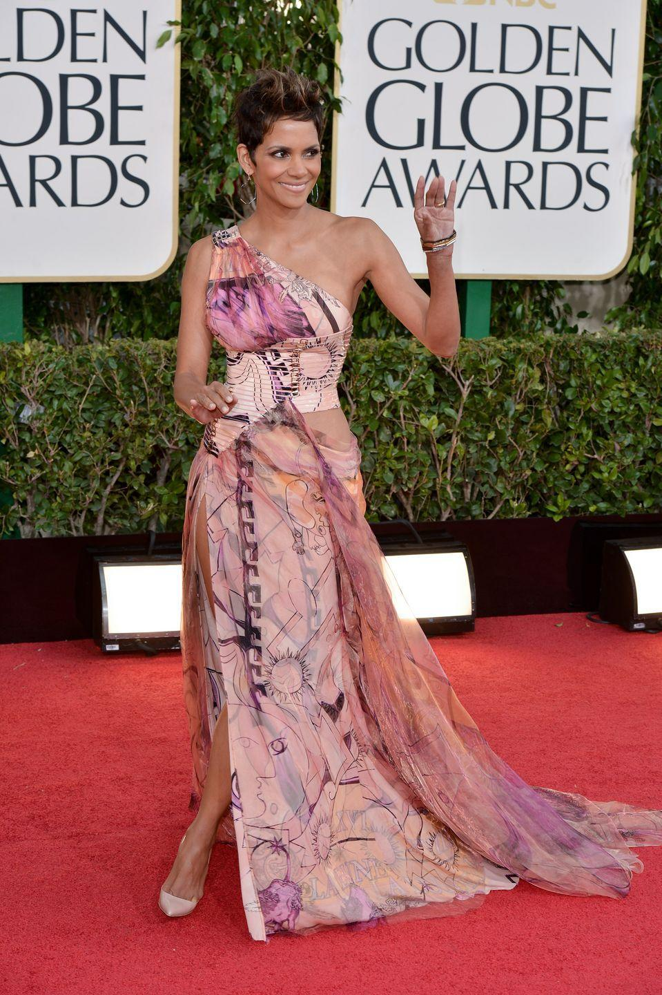 <p>The actress was a showstopper in 2013, wearing a printed, one-shoulder Versace dress featuring a super-high slit. </p>