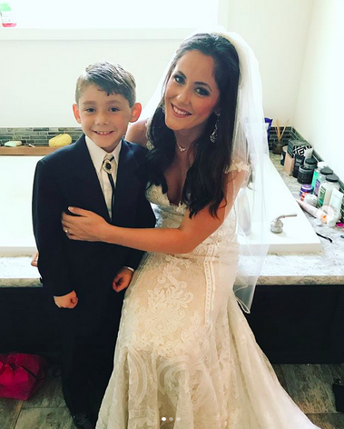 """<p>Evans was escorted down the aisle by son Jace, whom her mother, Barbara Evans, has custody of after an epically long battle. """"I was extremely honored to be walked down the aisle by this little man,"""" she wrote. """"He was happy for us, that's all that mattered for my big day. None of my family attended my wedding and I do not care, this boy is who mattered in the end. Jace did a great job and was super excited for the wedding to start!"""" (Photo: <a rel=""""nofollow"""" href=""""https://www.instagram.com/p/BZb-JT5Af8u/?hl=en&taken-by=j_evans1219"""">Jenelle Evans via Instagram</a>) </p>"""
