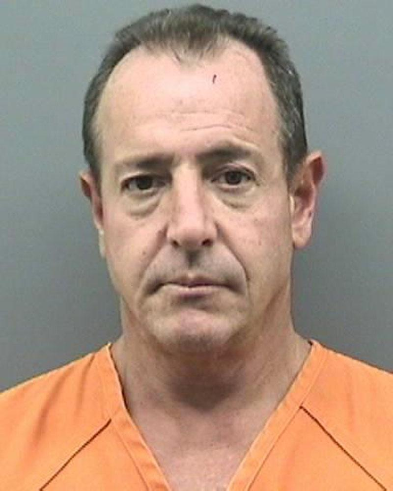 In this arrest photo made available by the Tampa Police Department, shows Michael Lohan following his arrest, Tuesday Oct. 25,  2011 in Tampa, Fla.  Lohan was arrested after police received a domestic violence call from his Tampa home. He was arrested for battery on his live-in girlfriend. (AP Photo/Tampa Police Department)