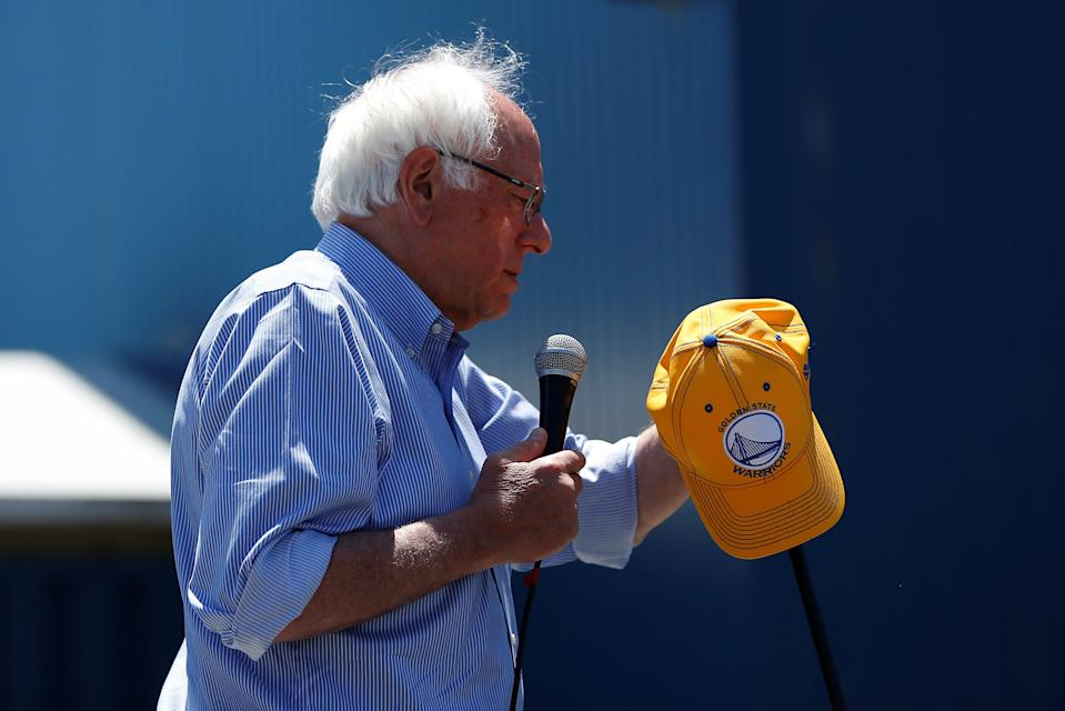 Bernie Sanders holds a Golden State Warriors hat during a campaign rally in Santa Cruz, Calif., May 31, 2016. (Stephen Lam/Reuters)
