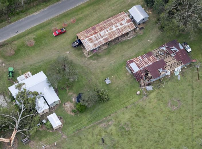 Fallen trees and damaged roofs are left in the aftermath of Hurricane Laura, Friday, Aug. 28, 2020, near DeRidder, La., as seen during Gov. John Bel Edwards' aerial tour of stricken areas in the northern part of the state. (Bill Feig/The Advocate via AP, Pool)