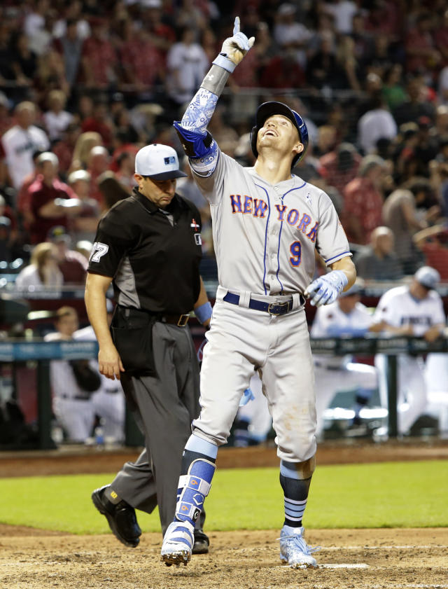 New York Mets' Brandon Nimmo reacts after hitting a two run home run against the Arizona Diamondbacks in the ninth inning during a baseball game, Sunday, June 17, 2018, in Phoenix. (AP Photo/Rick Scuteri)
