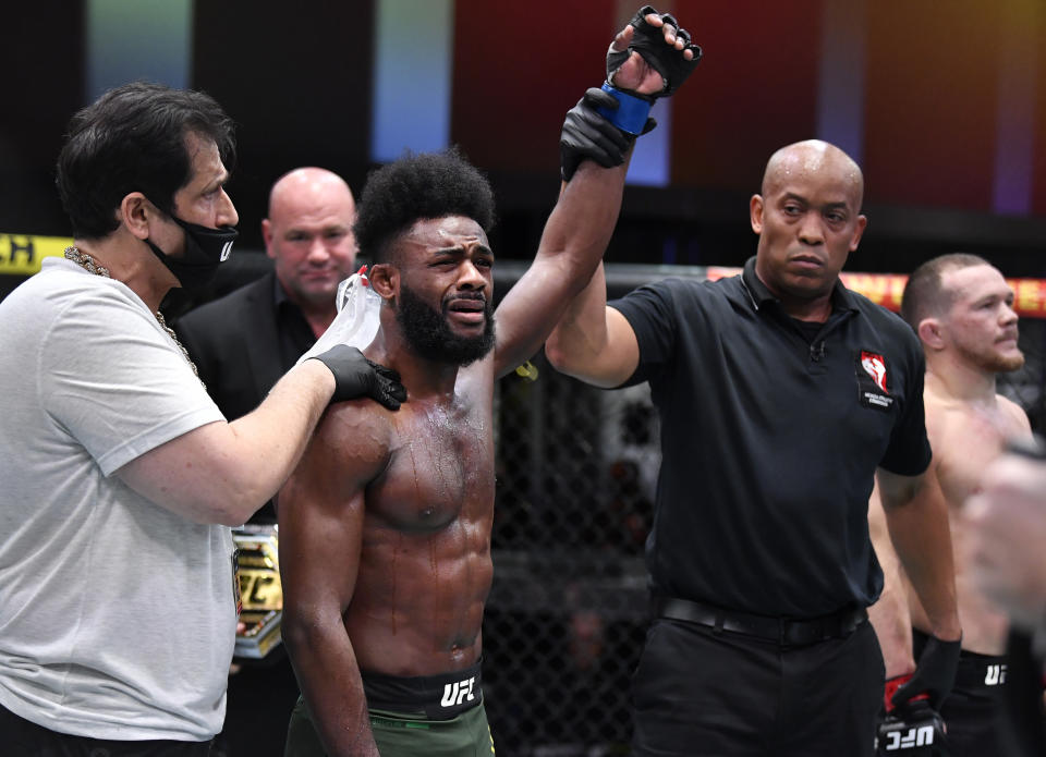 LAS VEGAS, NEVADA - MARCH 06: Aljamain Sterling reacts after his victory by disqualification over Petr Yan of Russia due to an intentional foul in their UFC bantamweight championship fight during the UFC 259 event at UFC APEX on March 06, 2021 in Las Vegas, Nevada. (Photo by Chris Unger/Zuffa LLC)