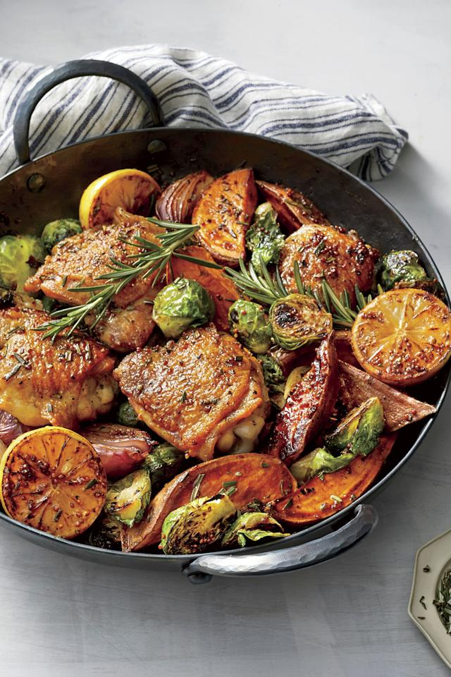 """<p>This pretty <a href=""""https://www.southernliving.com/dinner/one-skillet-meals"""">skillet supper</a> tastes (and smells) as good as it looks. Choose small <a href=""""https://www.southernliving.com/food/entertaining/chicken-thigh-recipes"""">chicken thighs</a>, which tend to be juicier and more flavorful than large ones. Serve with plenty of <a href=""""https://www.southernliving.com/bread/how-to-measure-flour-bake-bread"""">crusty bread</a> on the side for mopping up the pan sauce.</p> <p><a href=""""https://www.myrecipes.com/recipe/oven-baked-chicken-thighs-vegetables"""">Oven Baked Chicken Thighs with Vegetables Recipe</a></p>"""