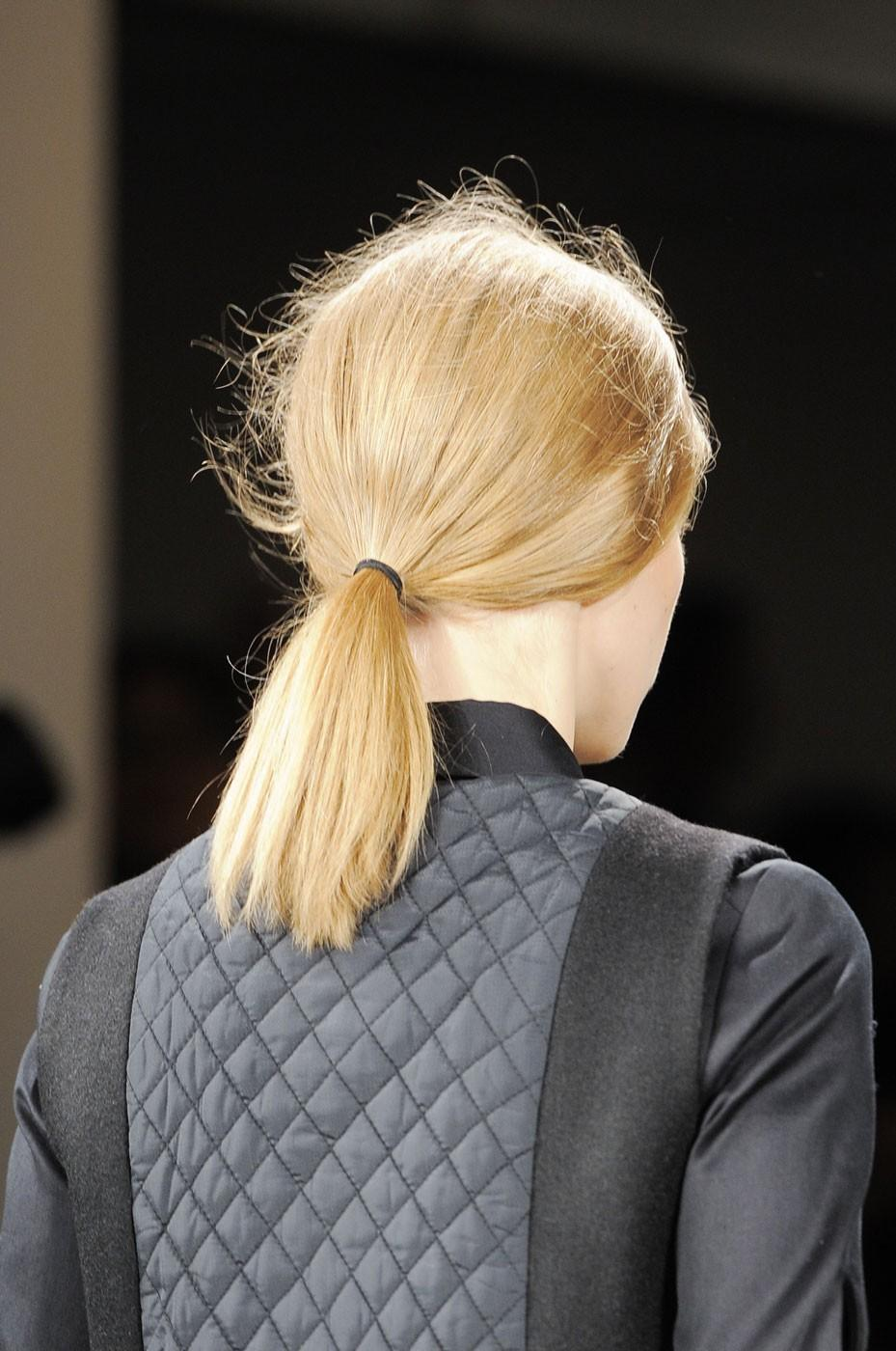 """<div class=""""caption-credit""""> Photo by: Stylecaster Pictures</div>Suno's collection was all about powerful armor, and a low ponytail is a statement of strength for women. <br> <br> <a href=""""http://beautyhigh.com/new-york-fashion-week-beauty-trends-you-can-wear/"""" rel=""""nofollow noopener"""" target=""""_blank"""" data-ylk=""""slk:See 25 More Wearable Trends From NYFW!"""" class=""""link rapid-noclick-resp""""><b>See 25 More Wearable Trends From NYFW!</b></a>"""