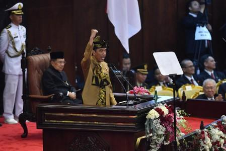 Indonesia President Joko Widodo gestures while delivering a speech in front of the parliament members ahead of Independence Day, at the parliament building in Jakarta