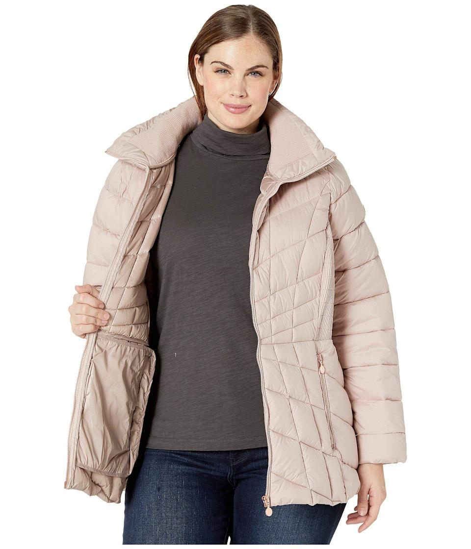 """<p><strong>Bernardo Fashions</strong></p><p>zappos.com</p><p><strong>$85.50</strong></p><p><a href=""""https://go.redirectingat.com?id=74968X1596630&url=https%3A%2F%2Fwww.zappos.com%2Fp%2Fbernardo-fashions-plus-size-ecoplume-packable-puffer-jacket-black%2Fproduct%2F9383326&sref=https%3A%2F%2Fwww.oprahmag.com%2Fstyle%2Fg33266496%2Fplus-size-coats%2F"""" rel=""""nofollow noopener"""" target=""""_blank"""" data-ylk=""""slk:SHOP NOW"""" class=""""link rapid-noclick-resp"""">SHOP NOW</a></p><p>With a nipped waist and strategic seaming, this figure-flattering puffer jacket is perfect for when you want to feel like you're wearing a sleeping bag—without <em>looking</em> like you're wearing a sleeping bag. Plus, it's made with the brand's proprietary EcoPlume cruelty-free insulation, an alternative to natural down that's designed to mimic its warmth and performance.</p>"""
