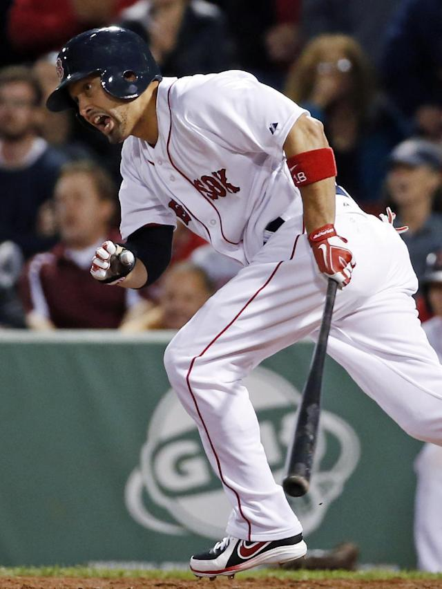 Boston Red Sox's Shane Victorino reacts as he grounds into a force out to end the baseball game against the Toronto Blue Jays at Fenway Park in Boston, Wednesday, May 21, 2014. The Blue Jays won 6-4. (AP Photo/Elise Amendola)