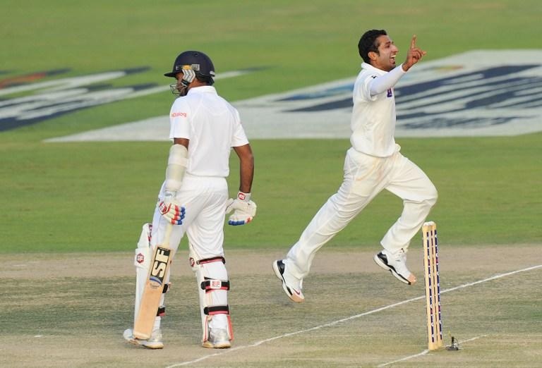 Pakistan bowler Bilawal Bhatti celebrates after dismissing Sri Lankan batsman Mahela Jayawardene (L) during the third day of the first cricket Test match between Pakistan and Sri Lanka at the Sheikh Zayed Stadium in Abu Dhabi on January 2, 2014. Pakistan's last six wickets fell cheaply on the third morning of the first Test and restrict them to 383. Sri Lanka's first-innings made 204 but they had to settle for a still-useful 179-run advantage. AFP PHOTO/Ishara S. KODIKARA