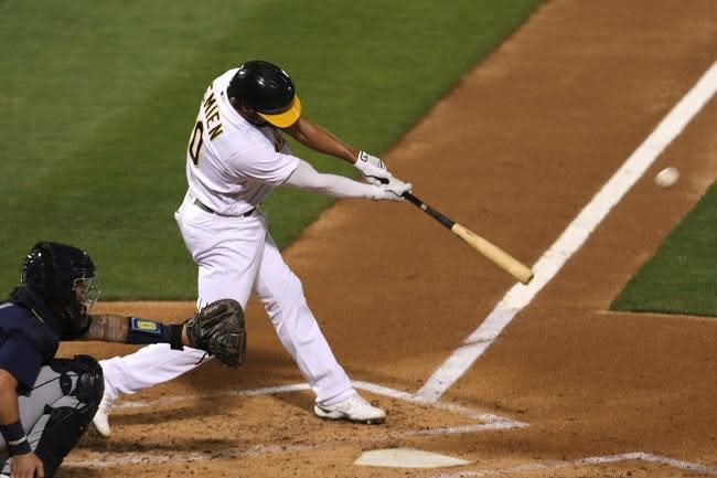 Canha homers in 10th inning, rallies A's past Mariners 3-1