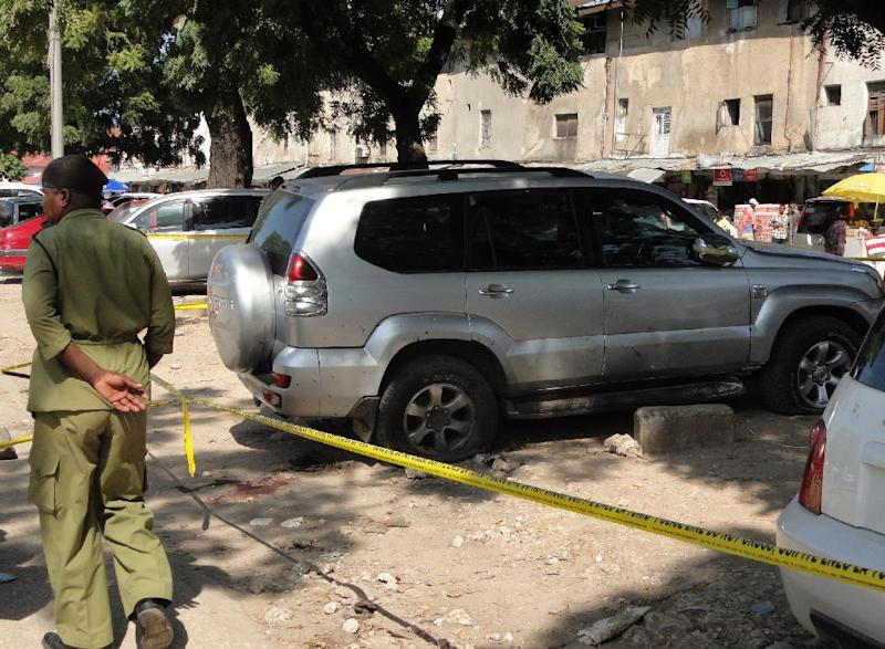 A Tazanian police officer stands guard in Zanzibar, on June 14, 2014 at the scene of a blast