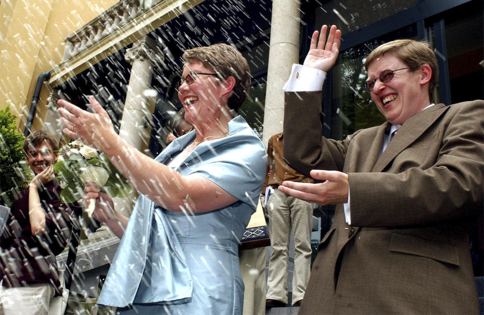 Belgians Marion Huibrechts, right, and Christel Verswyvelen leave the town hall of Kappelen, north Belgium, Friday, June 6, 2003. The two women became the first gay couple to marry in Belgium on Friday under laws passed earlier this year. Huibrechts and Verswyvelen celebrated 16 years of partnership with official vows at a civil ceremony. (AP Photo/Geert Vanden Wijngaert)