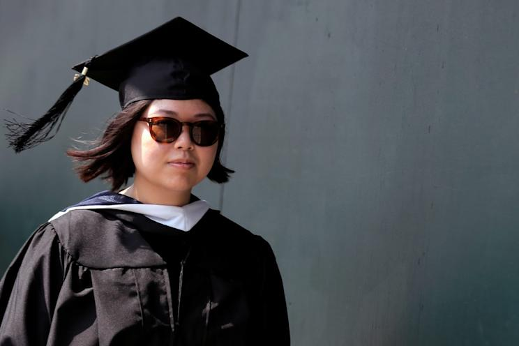 A graduate lines up for the Baruch College Commencement Exercise at the Barclay's Center in the Brooklyn borough of New York City, U.S., May 27, 2016. REUTERS/Brendan McDermid