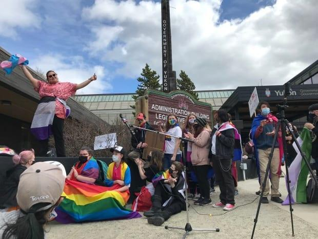 Grey Capot-Blanc of the group Northern Voices Rising reacts to the crowd chanting today in Whitehorse, 'Hey, hey, this is not OK!