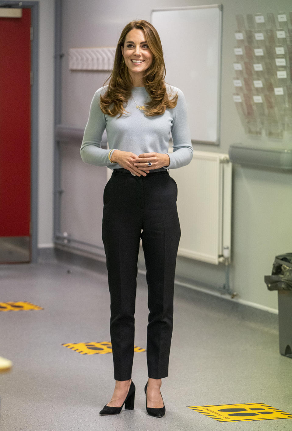 Kate Middleton looked polished in an aquamarine cashmere crewneck sweater by Massimo Dutti as she met with students and faculty at the University of Derby. Image via Getty Images.