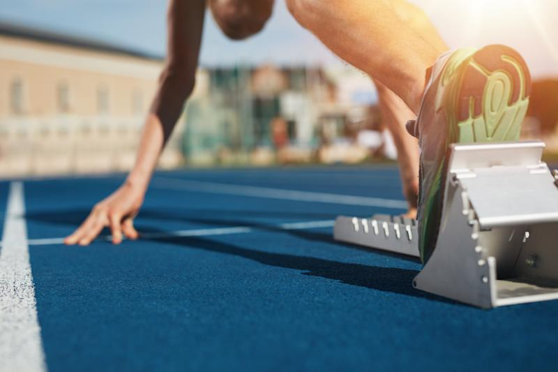 A person on a track in a starting block
