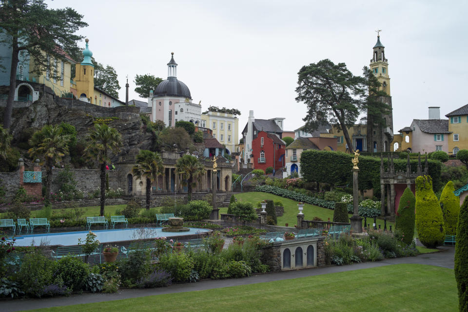 PORTMEIRION - WALES - JUNE 26: A general view over the tourist town of Portmeirion on June 26, 2019 in Portmeirion, North Wales. The village was designed and built by Sir Clough Williams-Ellis between 1925 and 1975 in the style of an Italian village. The town became  famous as 'The Village', the setting for the 1967 TV series 'The Prisoner', and is also well known for it's pottery. (Photo by Dan Kitwood/Getty Images)