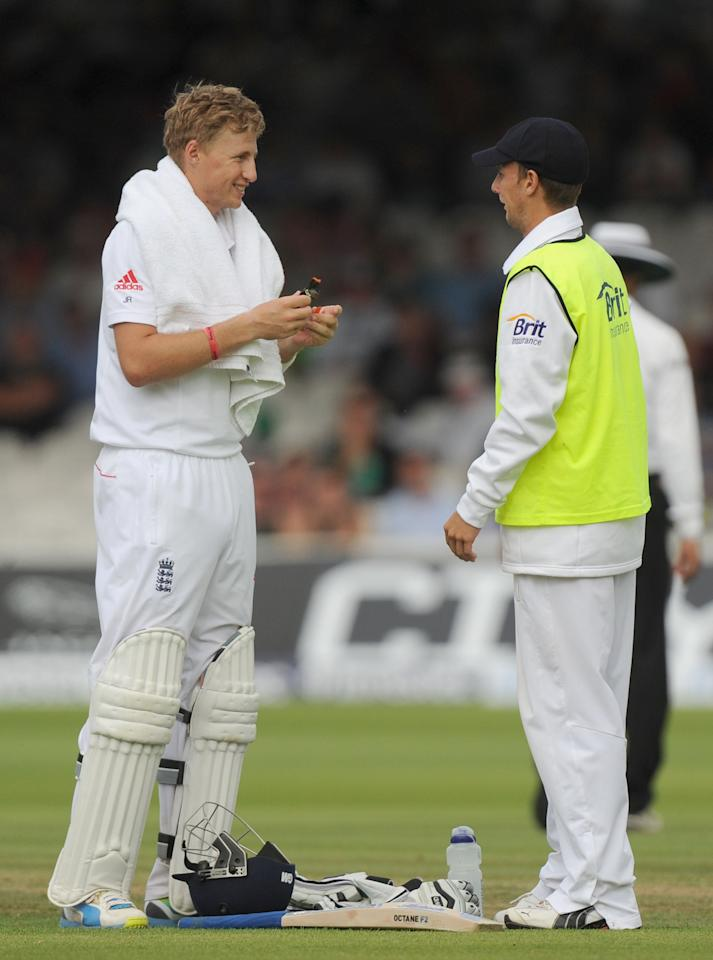 England's Joe Root (left) shares a laugh with brother Billy Root (right) England's 12th Man, on day three of the Second Investec Ashes Test at Lord's Cricket Ground, London.