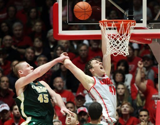 New Mexico's Cameron Bairstow, right, is fouled by Colorado State's Colton Iverson during the second half of their NCAA college basketball game in Albuquerque, N.M., Wednesday, Jan. 23, 2013. New Mexico won 66-61. (AP Photo/Eric Draper)