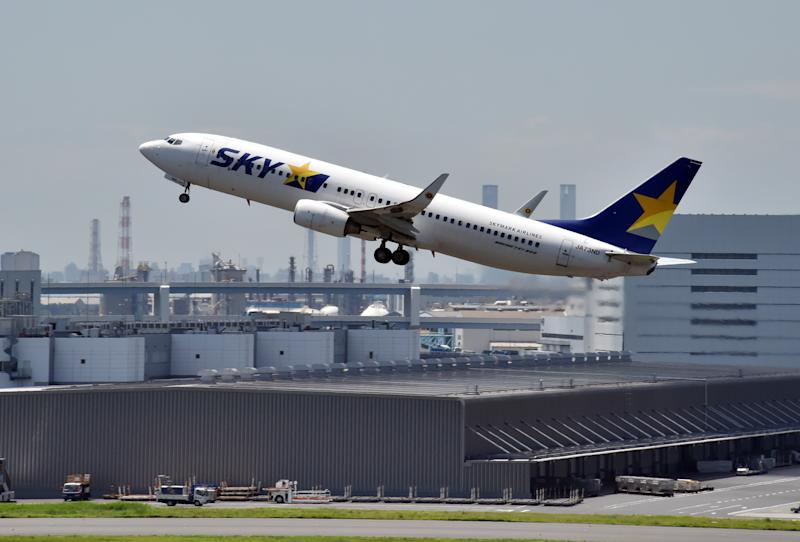 An airliner of Japan's Skymark Airlines takes off from Tokyo's Haneda airport on August 19, 2014
