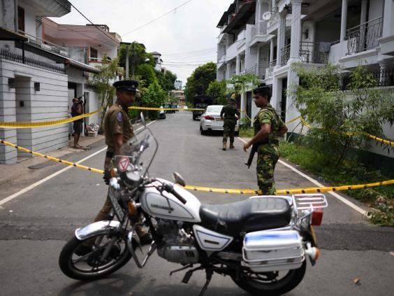 Sri Lankan security personnel stand guard around the house of one of the suspected suicide bombers in Colombo (AFP/Getty)