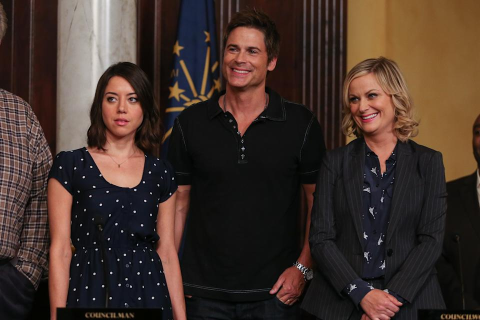 """Actors Aubrey Plaza, Rob Lowe, and Amy Poehler attend the """"Parks And Recreation"""" 100th episode celebration at the CBS Radford Lot on Wednesday, Oct. 16, 2013 in Studio City, Calif. (Photo by Paul A. Hebert/Invision/AP)"""