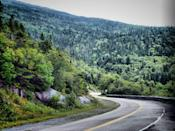 """<p><strong>The Drive:</strong> <a href=""""https://www.tripadvisor.com/Attraction_Review-g28953-d126758-Reviews-Whiteface_Veterans_Memorial_Highway-New_York.html"""" rel=""""nofollow noopener"""" target=""""_blank"""" data-ylk=""""slk:Whiteface Veterans Memorial Highway"""" class=""""link rapid-noclick-resp"""">Whiteface Veterans Memorial Highway</a></p><p><strong>The Scene:</strong> Head directly to the top of the <a href=""""https://www.tripadvisor.com/Attraction_Review-g48899-d103392-Reviews-Whiteface_Mountain-Wilmington_New_York.html"""" rel=""""nofollow noopener"""" target=""""_blank"""" data-ylk=""""slk:Whiteface Mountains"""" class=""""link rapid-noclick-resp"""">Whiteface Mountains</a> in upstate New York. This scenic byway takes drivers from the <a href=""""https://www.tripadvisor.com/Tourism-g48899-Wilmington_New_York-Vacations.html"""" rel=""""nofollow noopener"""" target=""""_blank"""" data-ylk=""""slk:small town of Wilmington"""" class=""""link rapid-noclick-resp"""">small town of Wilmington</a> to the mountain's summit at 4,867 feet. </p><p><strong>The Pit-Stop:</strong> At the top of the peak, explore <a href=""""https://www.tripadvisor.com/LocationPhotoDirectLink-g48899-d103392-i28405169-Whiteface_Mountain-Wilmington_New_York.html"""" rel=""""nofollow noopener"""" target=""""_blank"""" data-ylk=""""slk:Whiteface Castle"""" class=""""link rapid-noclick-resp"""">Whiteface Castle</a>, which was built from stone in the 1920s and offers striking panoramic views of the <a href=""""https://www.tripadvisor.com/Attractions-g4007676-Activities-Adirondacks_New_York.html"""" rel=""""nofollow noopener"""" target=""""_blank"""" data-ylk=""""slk:Adirondacks"""" class=""""link rapid-noclick-resp"""">Adirondacks</a>, <a href=""""https://www.tripadvisor.com/Tourism-g4672736-New_England-Vacations.html"""" rel=""""nofollow noopener"""" target=""""_blank"""" data-ylk=""""slk:New England"""" class=""""link rapid-noclick-resp"""">New England</a>, and <a href=""""https://www.tripadvisor.com/Tourism-g153339-Canada-Vacations.html"""" rel=""""nofollow noopener"""" target=""""_blank"""" data-ylk=""""slk:Canada"""" class=""""link rapid-noclick-resp"""">Canada</a>.</p>"""