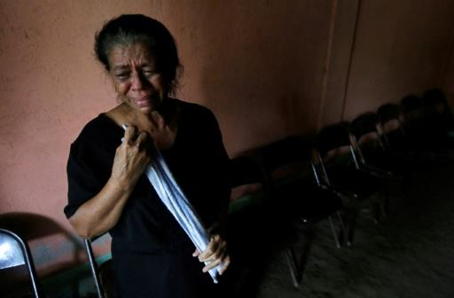 The mother a victim shot dead during recent protests against the government of President Daniel Ortega, shown here at her son's wake in the city of Sebaco