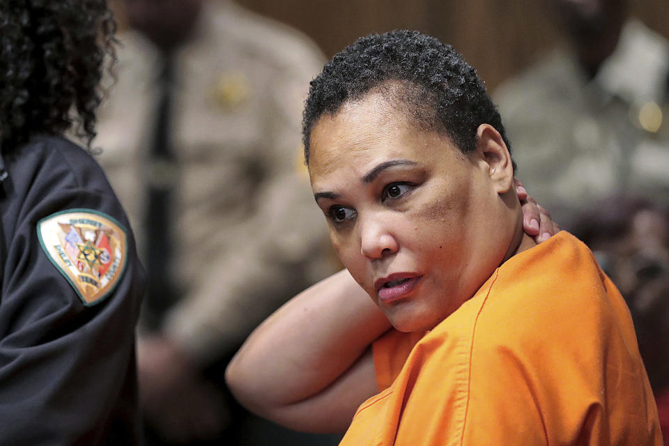 FILE - In this July 25, 2019, file photo, Sherra Wright listens as prosecutor Paul Hagerman reads a list of evidence against her during a hearing in Judge Lee Coffee's court in Memphis, Tenn. Judge Coffee, on Tuesday, June 8, 2021, has reset a hearing to address a request by Wright, the ex-wife of slain NBA basketball player Lorenzen Wright, to throw out her guilty plea in his 2010 killing in Memphis. (Jim Weber/Daily Memphian via AP, File)
