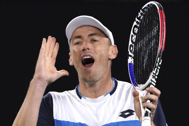 FILE - In this Jan. 24, 2020, file photo, Australia's John Millman reacts during his third round match against Switzerland's Roger Federer at the Australian Open tennis championship in Melbourne, Australia. Just four matches after his five-setter against Federer on one of the biggest stages in tennis, Millman was having to scramble to find a practice court. (AP Photo/Lee Jin-man, File)