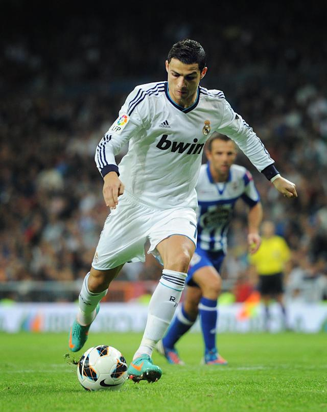 MADRID, SPAIN - SEPTEMBER 30: Cristiano Ronaldo of Real Madrid scores from the penalty spot during the la Liga match between Real Madrid CF and RC Deportivo La Coruna at the Santiago Bernabeu stadium on September 30, 2012 in Madrid, Spain. (Photo by Jasper Juinen/Getty Images)