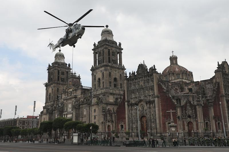 VARIOUS CITIES, MEXICO - SEPTEMBER 16: A Mexican Air Force helicopter performs a ceremonial flight during the Independence Day military parade at Zocalo Square on September 16, 2020 in Various Cities, Mexico. This year El Zocalo remains closed for general public due to coronavirus restrictions. Every September 16 Mexico celebrates the beginning of the revolution uprising of 1810. (Photo by Hector Vivas/Getty Images)