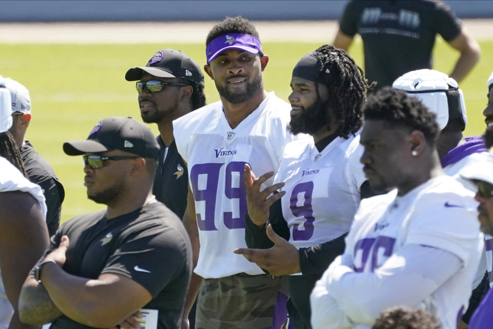 Minnesota Vikings defensive end Danielle Hunter (99) and defensive tackle Sheldon Richardson (9) chat during NFL football minicamp practice Tuesday, June 15, 2021, in Eagan, Minn. Hunter just signed a re-worked contract. (AP Photo/Jim Mone)